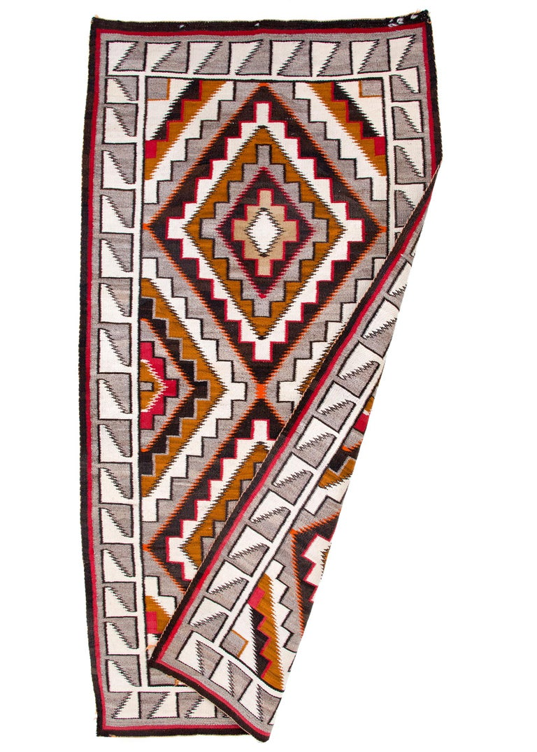 Vintage Navajo area rug from the Teec Nos Pos trading post, circa 1910, early 20th century. Native American Southwestern textile. Handwoven of native hand-spun wool in natural fleece colors of gray, ivory/white, dark brown, tan/camel with aniline