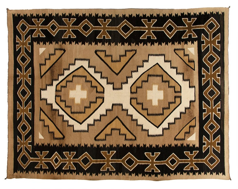 Vintage antique Navajo rug from the crystal trading post, crystal, New Mexico, circa 1930s-1950s. Handwoven by a Navajo weaver of native hand-spun wool in natural fleece colors of black, brown, camel and ivory. This textile is well suited for use on