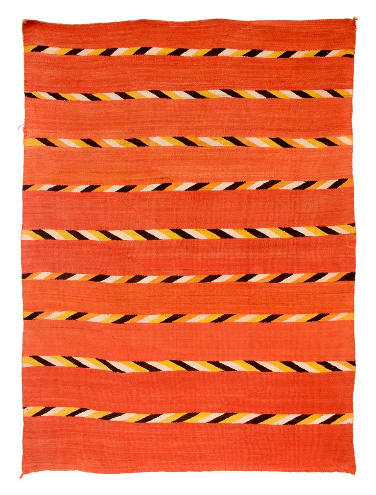 Antique 19th century Navajo textile, transitional blanket, circa 1880, finely woven of native hand spun wool in natural fleece colors of ivory and brown/black with aniline dyed orange and yellow in a banded design. Southwestern Native American
