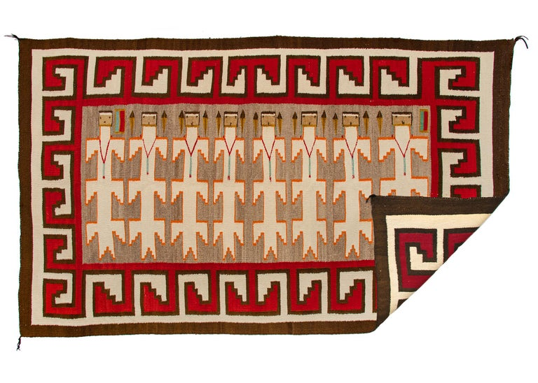 Antique/vintage 1930s Navajo pictorial weaving known as a Yei rug with 8 Yei figures, the Yeibichai or Talking Gods, are surrounded by a hooked border woven of native wool that was hand-carded, hand-spun and hand-woven by a Navajo weaver in colors