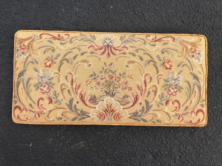 Vintage needlepoint upholstery piano bench cushion. Perfect to hang on a wall as a twin headboard or above a mantel. Or replace your piano bench top with this cushy piece. Detailed stitch work and solid well made romantic piece. By a Merriam Company