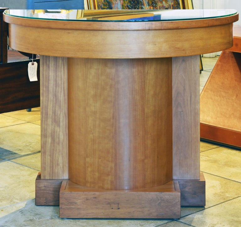 The architectural neoclassical style design and the warm color of the cherrywood make this demilune entry or hall table one of a kind. Great craftsmanship has been put into the manufacture of the table which bears a 'made in Canada' label.