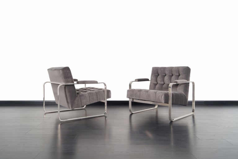 A stunning pair of vintage nickel lounge chairs designed by Milo Baughman for Thayer Coggin. The way the velvet seat seems to be floating inside the nickel-plated frame gives the design an amazing perspective from any angle. Professionally re-plated
