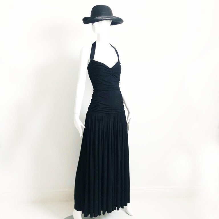 Fabulous vintage Norma Kamali jumpsuit with halter and palazzo wide leg pants.  Made from black nylon/lycra jersey, the bodice is ruched and fitted, the pants have tons of fabric (54in hem sweep).  Unlined/hand wash.  No size tag but estimated as a
