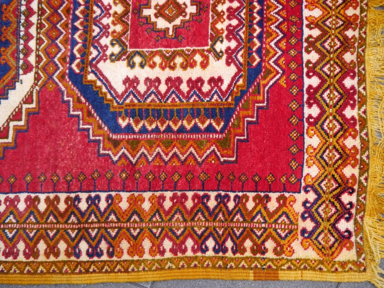 Beautiful hand knotted rug from North Africa. This great vintage piece was made by women of the Berber Ait Khozema tribe in Morocco. These people are at home in the Atlas Mountains, living at an altitude of about 5000-6000 ft. The weather is very