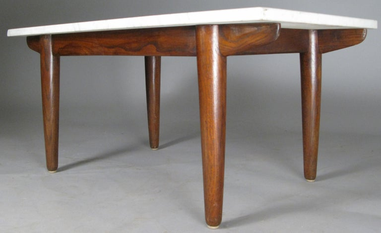 A very handsome 1950s coffee table with a base of beautifully grained oak, and a white & grey italian marble top.