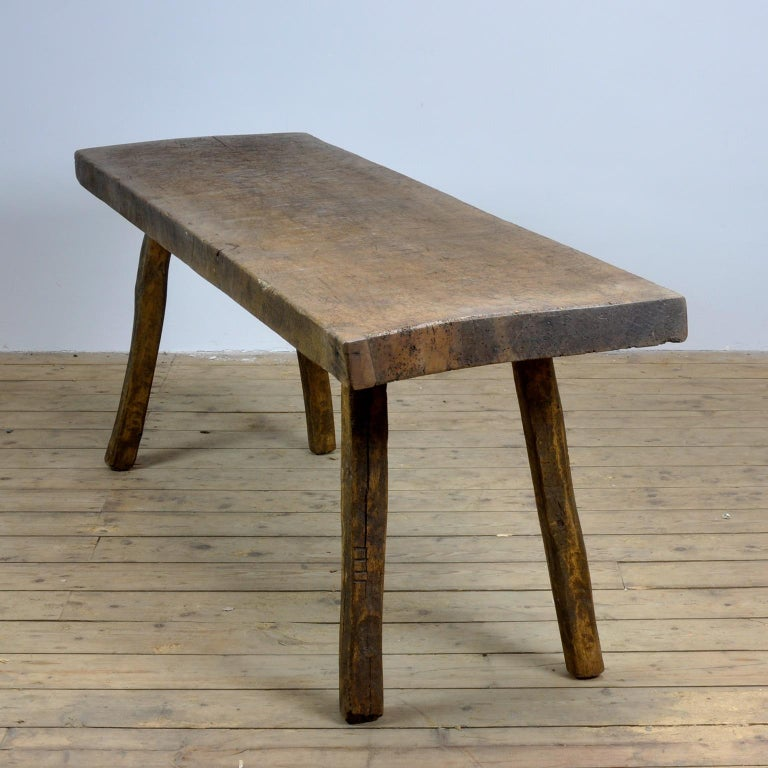 This oak butcher's farm table was produced in Hungary, circa 1930s. With a nice distressed oak top of 7.5 cm thick made out of one single piece of oak. It has its original legs witch are marked by the maker (I to IIII) This piece has been