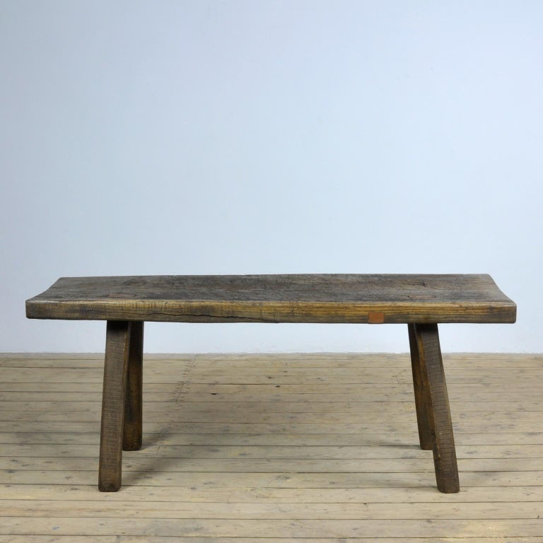This oak butcher's farm table was produced in Hungary circa 1930s. With a nice distressed oak top of 8 cm thick. This piece has been wax-finished. Treated for woodworm.