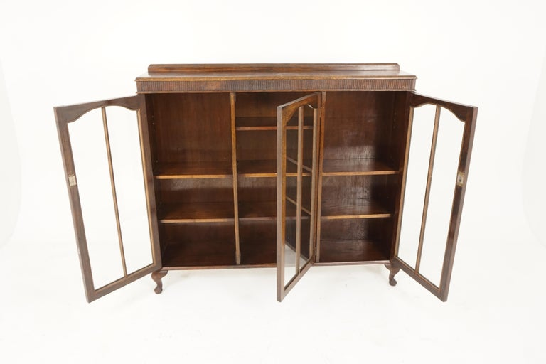 Vintage oak three-door bookcase, display cabinet, Scotland 1930, B2236  Scotland, 1930 Solid oak Original finish Pediment top on rectangular moulded top, Three dome shaped doors underneath Opens to reveal pair of adjustable shelves to the