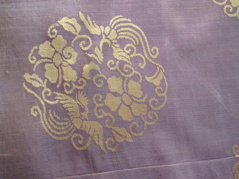 Vintage obi brown and gold silk textile with flowers and birds medallions.