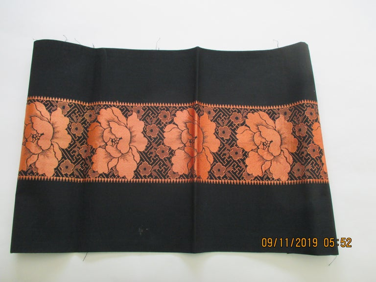 Vintage obi textile fragment orange on black. Sash textile woven and embroidered large flowers and trellis design. Ideal for a pillow or upholstery. Size: 12