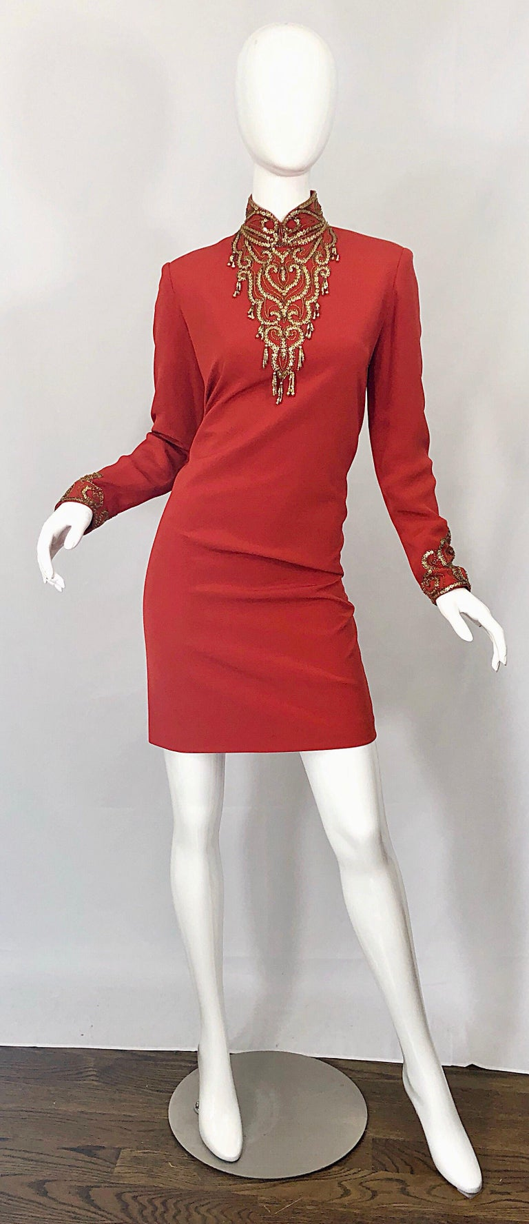 Beautiful vintage OLEG CASSINI burnt orange and gold beaded long sleeve high neck silk cocktail dress! Features hundreds of gold beads around the neck, chest and each sleeve cuff. Chic gold beaded tassels adorn the edges on the chest. Full lined.