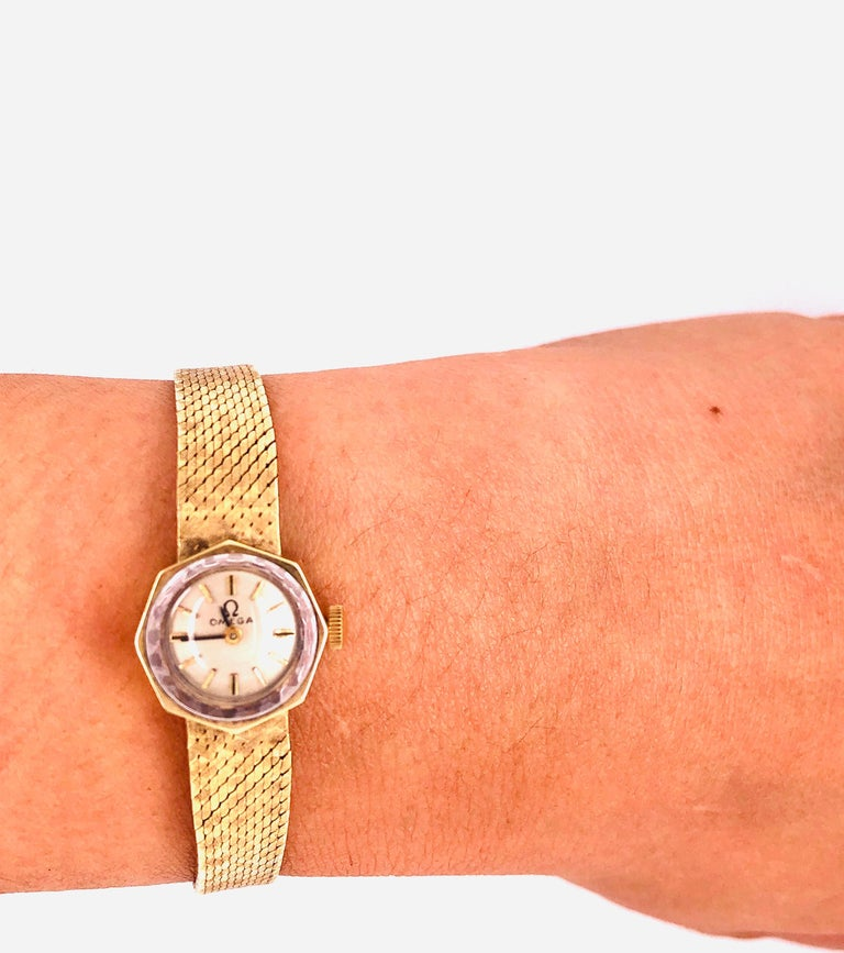 Vintage Omega 14 KT Ladies Watch 18.2 grams Without Works. 17 Jewels having a mesh 6.5 inch band. The watch face itself is 1/2 inch in diameter.  Omega SA is a Swiss luxury watchmaker based in Biel/Bienne, Switzerland.[1] Founded by Louis Brandt in