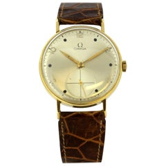 Vintage Omega Manual Winding Wristwatch in 18 Karat Gold, circa 1950s