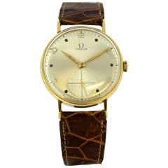 Vintage Omega Men's Manual Winding Wristwatch in 18 Karat Yellow Gold, 1950s