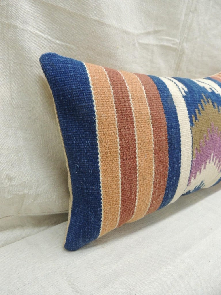 Vintage orange and blue Navajo style woven decorative lumbar pillow with woven linen backing. Decorative pillow handcrafted and designed in the USA. Closure by stitch (no zipper closure) with custom made pillow insert. Size: 11