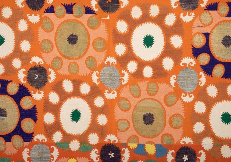Unusually colorful suzani from Samarkand, Uzbekistan. Cotton embroidery on a cotton background.
