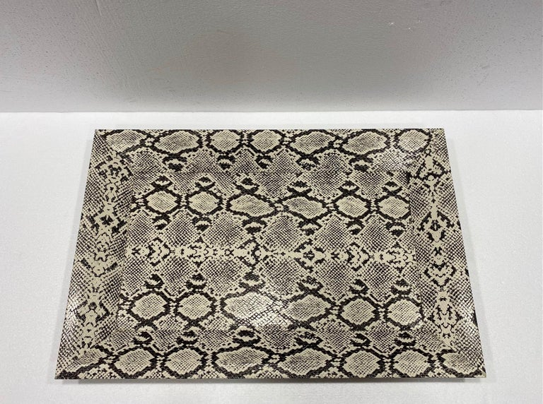 Mid-Century Modern style decorative tray with shadowbox design. Handcrafted with wood frame wrapped in faux leather and embossed python print in hues of black and cream. Makes a great coffee table accessory and a great addition to any barware set.