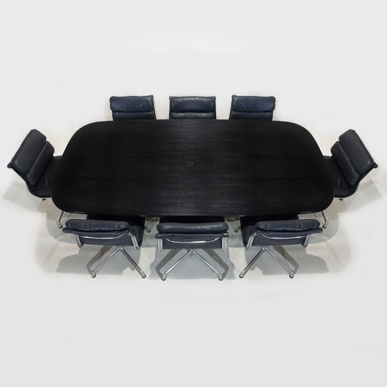 An exceptional vintage Charles and Ray Eames Boardroom table and chair set with original Vitra table and 8 dark grey leather Herman Miller soft pad chairs.  Dating from the mid-1980s this is a truly rare and beautiful example of a complete