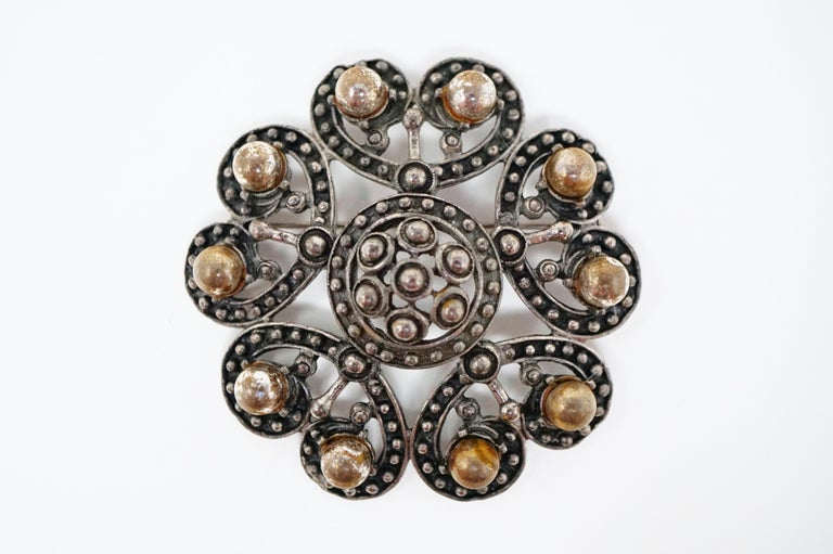 This rare silver tone brooch by Florenza, circa 1960, is an ornate piece inspired by the Victorian era.  The rich gunmetal tone and heft of this piece make it a very unique piece of vintage costume jewelry from the coveted brand Florenza. A