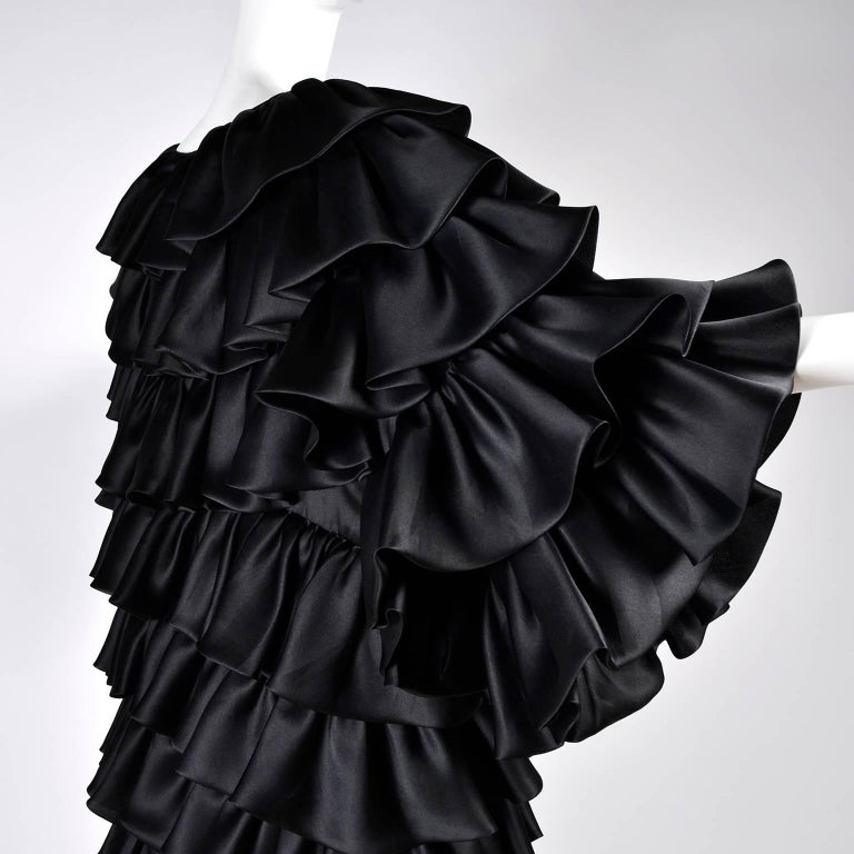 This ruffled black vintage Oscar de la Renta coat was purchased at Lord & Taylor and made in the USA in the early 1990s. This gorgeous evening coat has tiers of black ruffles and is lined in fine organza.  It's hard to photograph the way the