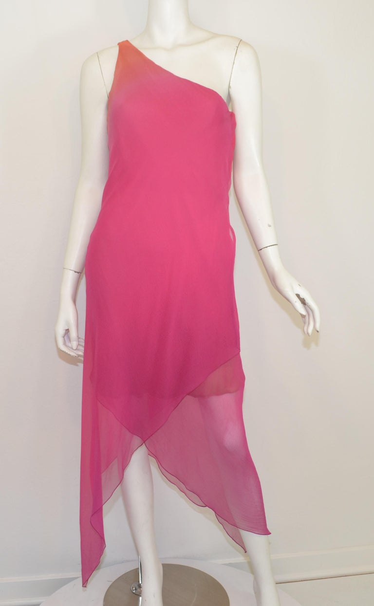 Oscar de la Renta dress features an ombre color scheme with a one-shoulder design. Dress is composed with silk chiffon, has a boned bust/waist, side zipper and snap button fastening, asymmetric hem, and double silk chiffon lining. Dress is in great