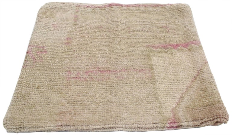 52228, vintage Oushak pillow cover with soft muted colors. For a polished look on beds, sofas or chairs, this vintage Oushak pillow cover helps creates a warm and cozy space. This pillow cover was made from a vintage Oushak rug. It features a