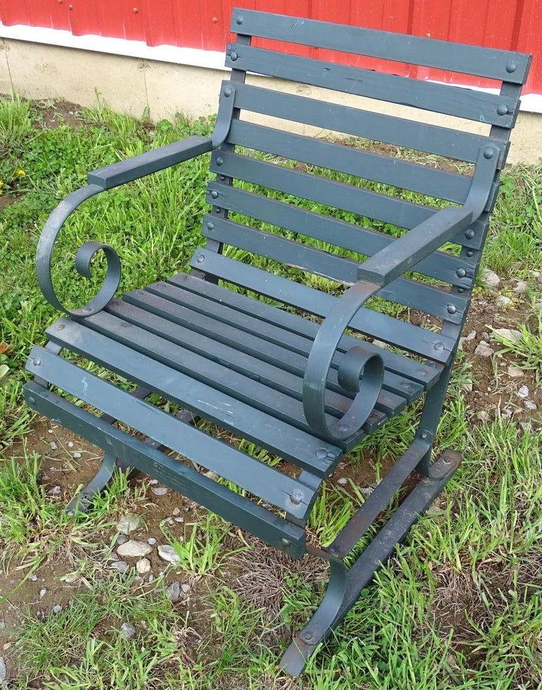 Wonderfully styled painted wood and metal garden, patio or porch lounge chairs. The low seat height makes them highly inviting for a gathering and conversation. These outdoor wood and metal garden chairs have generously wide proportions. Chairs are