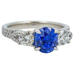 Vintage Oval Cut Blue Sapphire, Platinum, and Diamond Ring