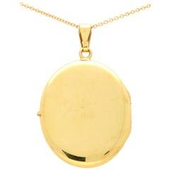 Vintage Oval Photo Locket Set in 18 Karat Yellow Gold