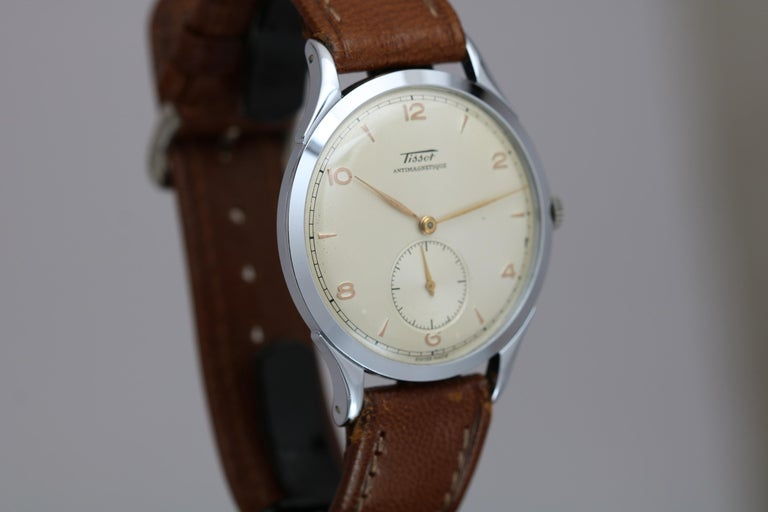 Vintage Over-Sized Tissot Antimagnetique wristwatch in stainless steel with a manual wind movement. Comes with hangtag.  38mm circa 1950