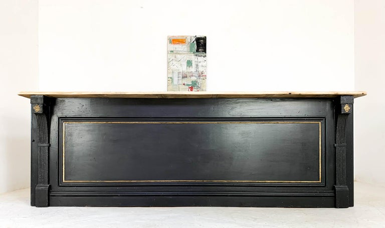 Stunning pine shop counter which has been fully restored to bring it back to it's former glory. The paneled front features decorative corbels at either end and gold paint that highlights and details the moldings. The top is a later addition made