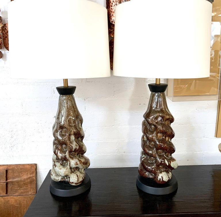 A nice pair of restored ceramic lamps. There have been redone and feature new shades. Shades are 18 inches in diameter. Minor wear with original fittings although they have been re-wired.