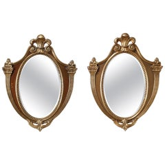 Vintage Pair of French Shield Form Parcel-Gilt Mahogany Wall Mirrors, circa 1940