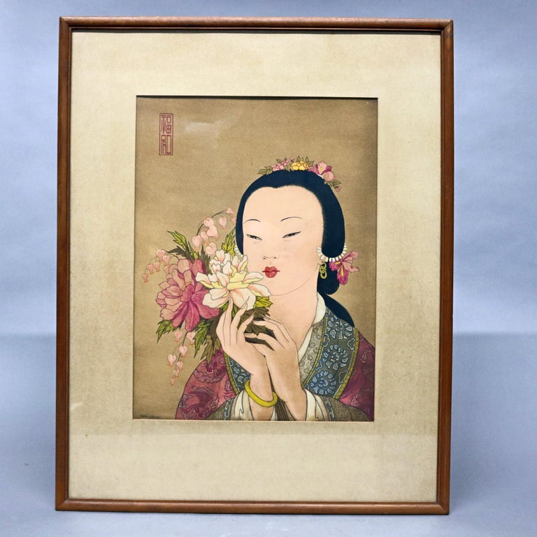 A vintage pair of Japanese woodblock portrait prints depicting Geisha Girls with flowers, stamped as photographed, 20th century.  DELIVERY NOTICE – Due to COVID-19 we are employing NO-CONTACT PRACTICES in the transfer of purchased items.