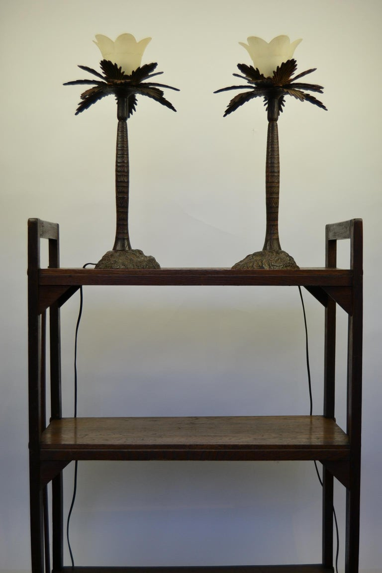 Pair of Brutalist Palm Tree Table Lamps.  This Palm Tree Table Sculptures date circa 1950s-1960s. They have Fine detailed Trunk and Leafs.  Made of Heavy Metal - Cast metal - Painted Metal with Frosted Art Glass Shades.   Stylish Pair of Palmtree