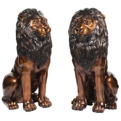 Vintage Pair of Cast Bronze Seated Lions, 20th Century