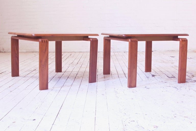 Great vintage pair of well-made and substantial teak side tables with floating tops and exposed finger joinery. Lovely timber selection with both quarter and flat sawn boards adding variety and dynamism to the laminated tops demountable construction