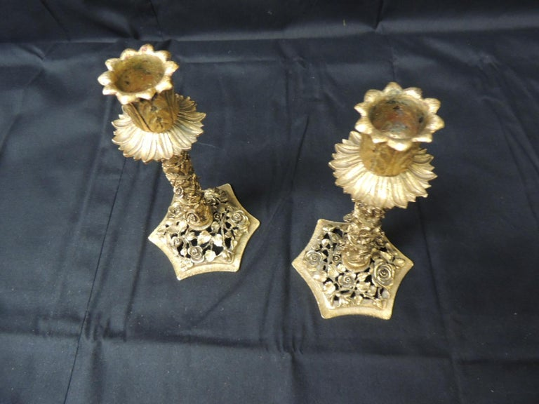 Vintage pair of candlesticks with elaborate filigree of roses and flowers. (heavy) by Matson Size: 4 x 4 x 7 H.