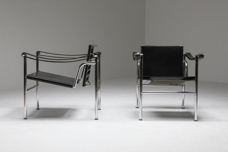 Le Corbusier, LC 1, black leather, Cassina 1965  A light, compact chair designed and presented at the 1929 Salon d'Automne along with other important models, such as the LC2 and LC3 armchairs, the LC6 table and the LC4 chaise-longue. As with all