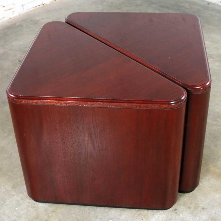 Handsome pair of triangular end tables, side tables or pedestals in mahogany veneer. They have nice detail. Plus, they are in wonderful vintage condition. Please see photos. circa late 20th century. We were excited here at the shop when we ran