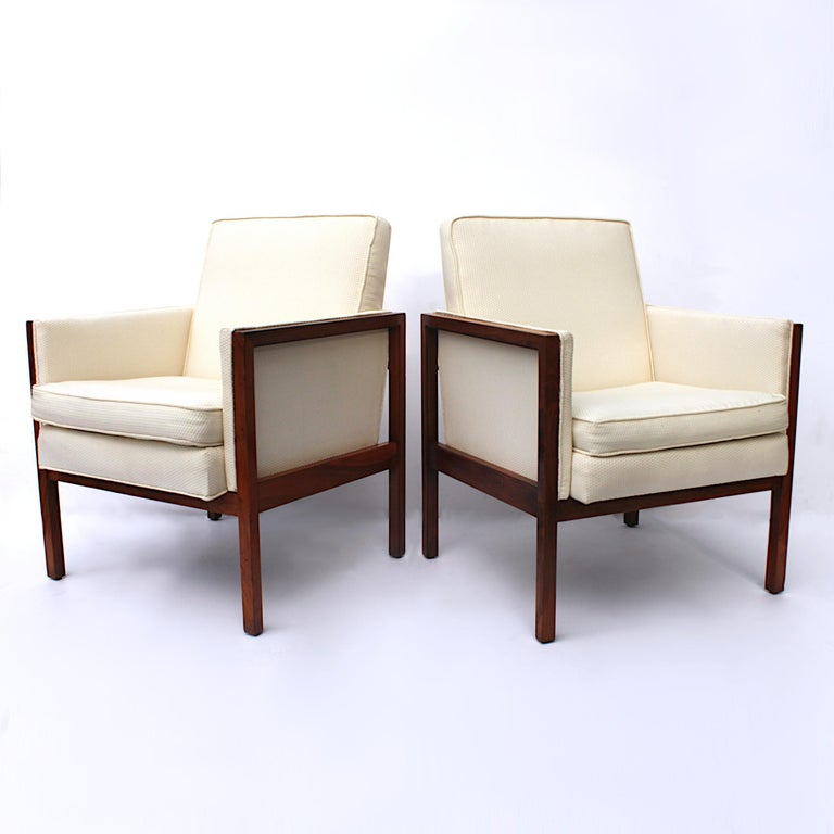 Wonderful pair of side chairs by Jens Risom design.   Chairs feature:  - Solid walnut frames - New textured off-white upholstery - Great architectural/Minimalist lines  The new, textured off-white upholstery is beautifully complemented by