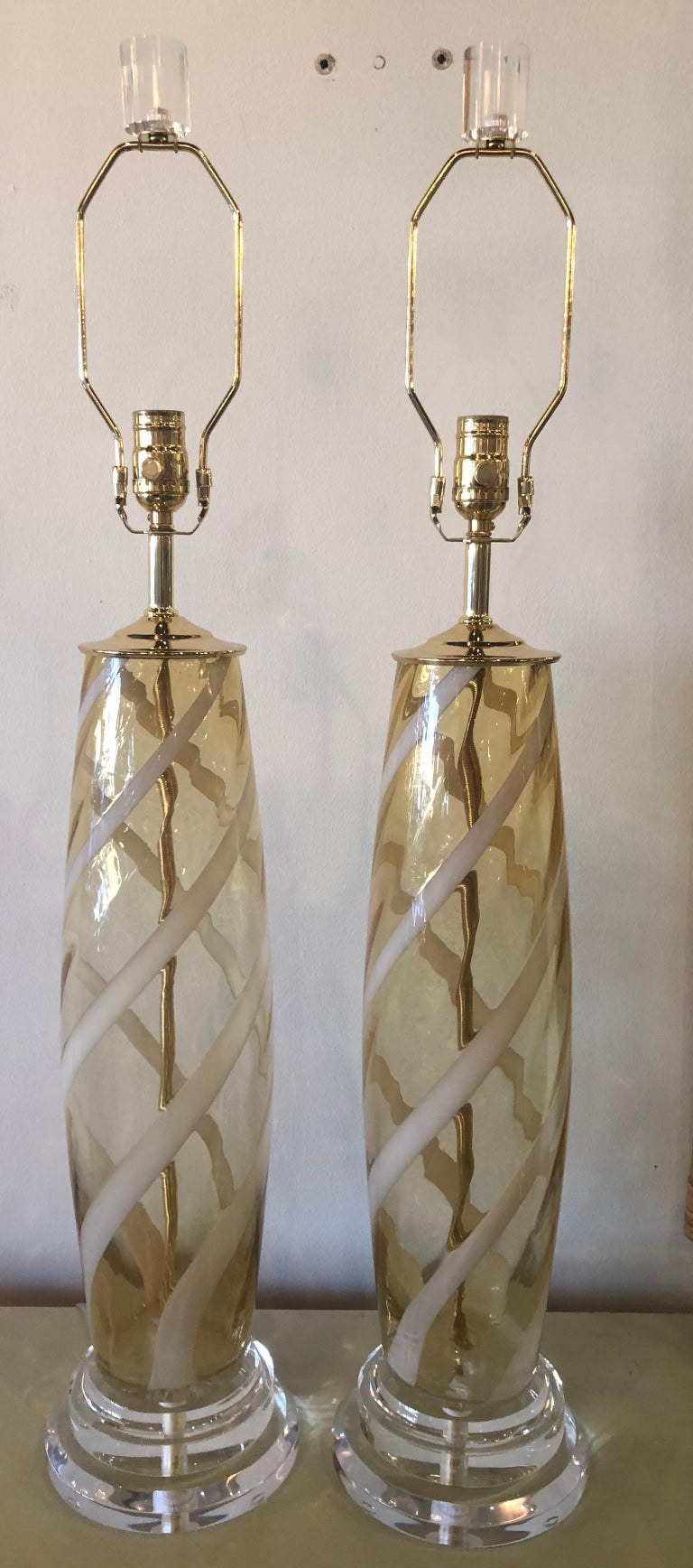 Vintage Italian glass Murano table lamps, pair. These have been newly rewired, new brass hardware, Lucite base and finials. Meticulously restored to perfection!