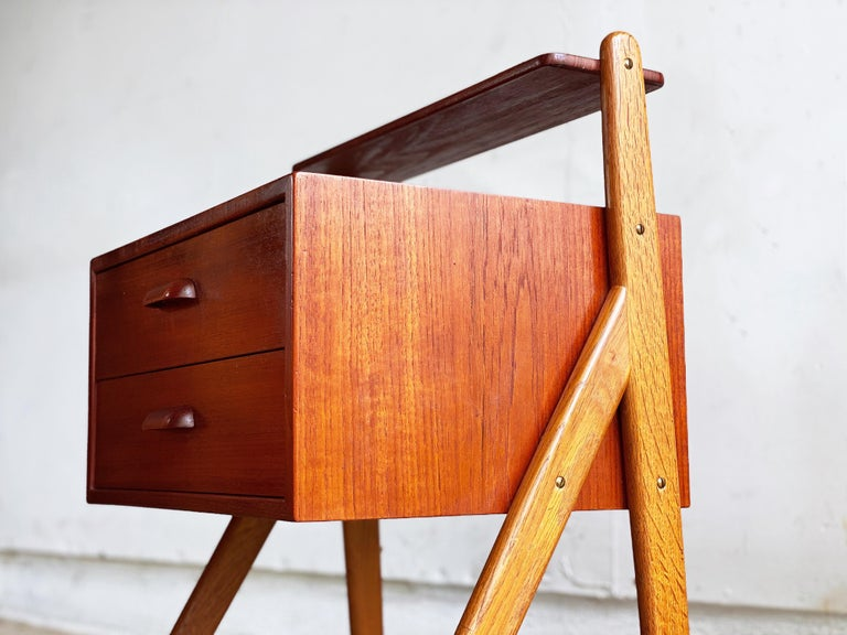 This petite pair of Danish nightstands designed by Sigfred Omann for Olholm Møbelfabrik are in overall great condition. Top shelf constructed of solid teak. I love the way oak frames contrast with the teak bodies. Decently uncommon design,