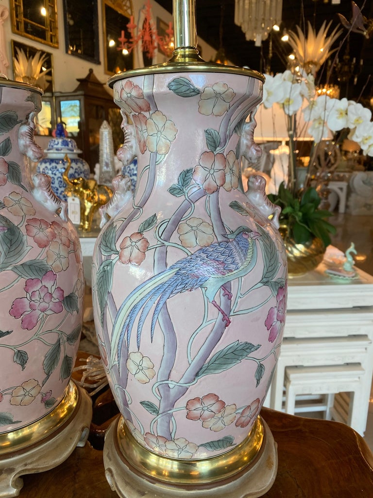Vintage pair of pale pink chinoiserie ginger jar table lamps. Bird and floral design. Brass has been polished. Lamps have been newly wired, all new brass hardware, 3 way socket. No chips or breaks.  Measures: 23