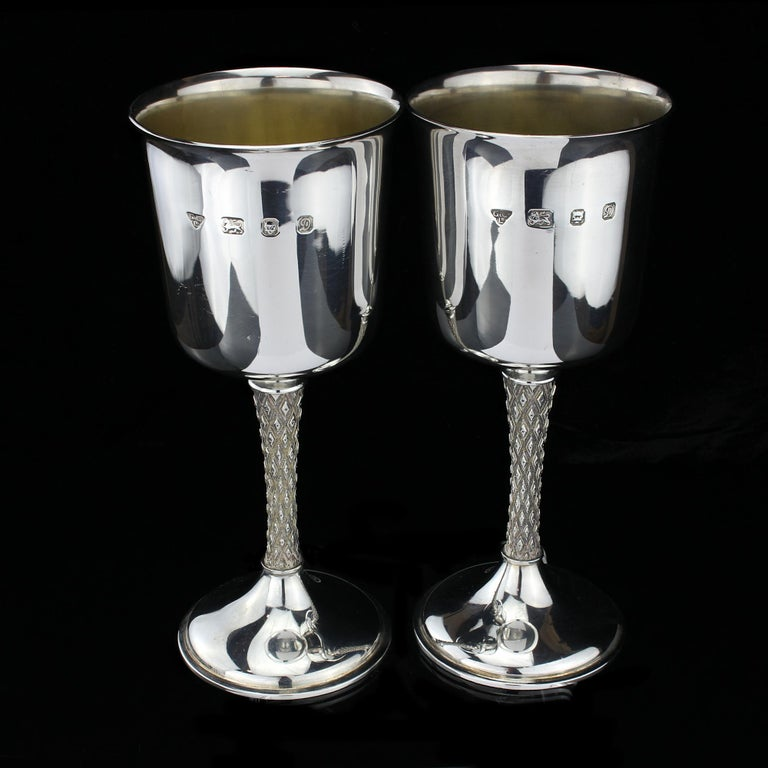 You've been looking for a set of goblets to match your silverware, but you can't find anything that's just right.  These vintage sterling silver goblets are the perfect addition to any table setting! They're made by Garrard & Co and designed by