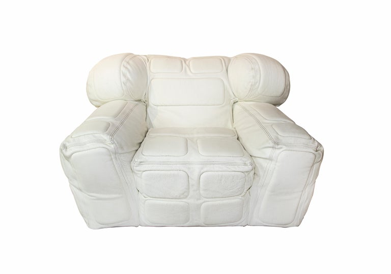 white armchairs is a piece designed by Arik Ben Simhon in 2002.  100% leather.  Very rare iconic pair of armchair of great success and popularity.  Arik Ben Simhon is an Israeli designer whose latest furniture collection was inspired by sports