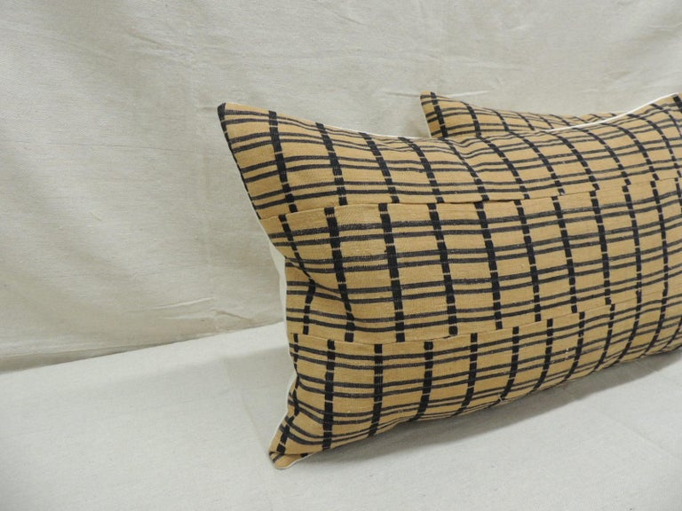 Vintage pair of yellow and dark blue African stripweaves lumbar decorative pillows with heavy woven linen backings. Decorative pillow handcrafted and designed in the USA.  Closure by stitch (no zipper closure) withcustom made pillow