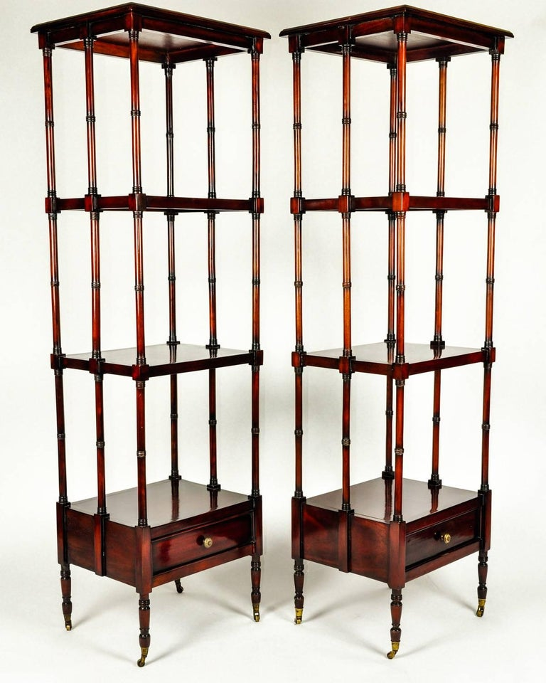 Vintage pair solid mahogany wood display shelves / etageres with lower bottom drawer. Both pieces are in excellent vintage condition. Minor wear consistent with age / use . Each etagere / shelve measure 61 inches high x 18.5 inches width x 16 inches