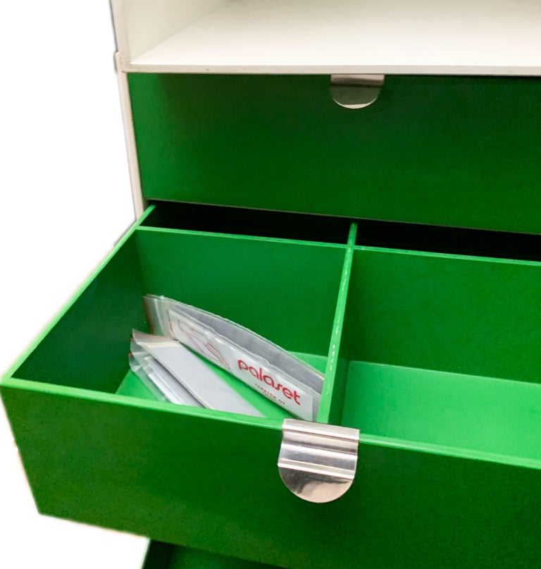 Vintage Palaset modular storage box set of 4 Scandinavian Modern, Finland, 1972-1973, green and white.  Palaset Palanox, multicolored stackable boxes that allow you to build your own shelf, only produced for a few years in the early 1970s. During